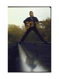 Country/Western Singer Johnny Cash with Guitar Straddling Railroad Tracks Art sur métal  par Michael Rougier