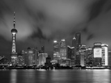 City Skyline at Night with Oriental Pearl Tower and Pudong Skyscrapers across the Huangpu River, Sh Fotografie-Druck von Neale Clark