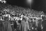 Cheer Leaders at Little Rock High School Game with Louisiana High School Team Reproduction photographique par Stan Wayman