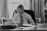 Informal Portrait of President Bill Clinton at His Desk in the Oval Office Photo