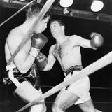 Heavyweight Champion Rocky Marciano (Right) Backs Roland Lastarza Against the Ropes Foto