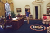 Chelsea Clinton Playing with Socks the Cat in the Oval Office Valokuva