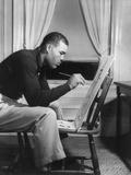 Boxer Joe Louis Painting a Picture for Urban League Guild Exhibit, Sept. 1949 Photo