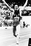 Bruce Jenner Just after Crossing the Finish Line to Win the Decathlon Fotografía