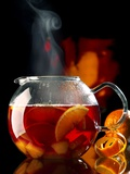 Steaming Red Wine Punch with Pieces of Fruit in Glass Teapot Photographic Print by Jürgen Klemme