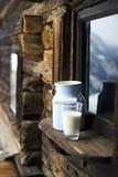 Milk Can and Glass of Milk on Window Sill of Alpine Chalet Fotografie-Druck von Sabine Mader