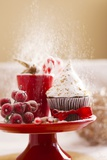 A Christmas Cupcakes in an Icing Sugar Snowstorm Fotografie-Druck von Rogério Voltan