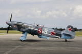 A Soviet Air Force Yak-3 Replica on the Runway Photographic Print by  Stocktrek Images
