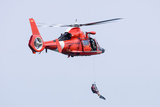 A Rescue Swimmer Is Lowered from a U.S. Coast Guard Hh-65 Dolphin Helicopter 写真プリント : ストックトレック・イメージ(Stocktrek Images)