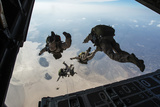 U.S. Pararescuemen and U.S. Marines Jump from a Hc-130 over Djibouti Fotografisk tryk af Stocktrek Images,
