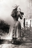 Annie Oakley Shooting over Shoulder Photographic Print
