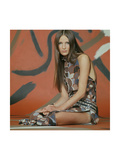 Model, Kneeling on Floor in Front of a Red and Brown Backdrop Premium Giclee Print by Franco Rubartelli