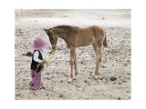 Child in Western Wear Feeding a Pony Giclee Print by Nora Hernandez