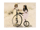 Two Little Girls by an Old Fashioned Bicycle Giclee Print by Nora Hernandez