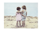 Boy and Girl with their Arms around Each Other on the Beach Giclee Print by Nora Hernandez