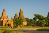 Myanmar. Bagan. Red Brick Temple Glows in the Late Afternoon Light Reproduction photographique par Inger Hogstrom