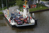 A Car Ferry on the Kiel Canal, Germany Photographic Print by Dennis Brack