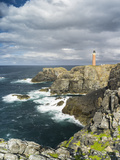 Isle of Lewis, Coast and Lighthouse at the Butt of Lewis. Scotland Foto av Martin Zwick