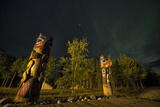 Totem Poles at Night. Tlingit Culture Symbols at the Community Visitor Interpretation Center Photographic Print by Peter Mather