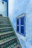 A Blue Wall and a Tiled Staircase in the Garden of Le Jardin Des Biehn Photographic Print by Richard Nowitz