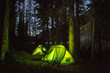 Tents Glow in the Gathering Dark after a Day of Llama Trekking, and Hiking in the Swan Range Fotografie-Druck von Ami Vitale