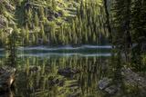 A Beautiful Alpine Lake Glows in the Morning Light, Deep in the Swan Mountain Range Fotografie-Druck von Ami Vitale