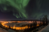 The Aurora Borealis Above the City Lights of Whitehorse Photographic Print by Peter Mather