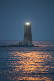 Red Moonlight Reflects Off Seawater in Front of Whaleback Lighthouse Stampa fotografica di Robbie George