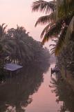 Sunset Creates a Beautiful Pink Hue in the Backwaters Impressão fotográfica por Kelley Miller