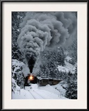 A Train Chugs Through the Snow Blanketing the San Juan Mountains Framed Photographic Print by Paul Chesley
