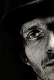 Cropped Portrait of a Man with Hat Starring into the Camera Photographic Print by Torsten Richter