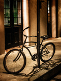 Bicycle Leaning Against Post in USA Photographic Print by Jody Miller
