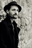 Close Up of Young Male Figure Wearing Black Jacket and Hat with Beard Photographic Print by Torsten Richter