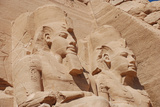 Statues of Pharaoh Ramesses II decorating facade of temple, The Great Temple, Abu Simbel, Nubia Photographic Print by Derek Hall