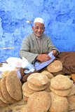 Vendor with Freshly Baked Bread, Rabat, Morocco, North Africa Fotografie-Druck von Neil Farrin
