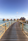 Water Bungalows of Pearl Beach Resort, Rangiroa Atoll, French Polynesia Stretched Canvas Print by Matteo Colombo