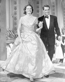 Indiscreet Woman in Dress and Man in Black Suit Walking Photo by  Movie Star News