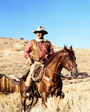 John Wayne on horse in mountains Photographie par  Movie Star News