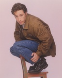 Jon Stewart Top of a Chair Portrait Foto af  Movie Star News