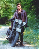 John Stamos posed Brown Jacket in a Motorcycle Portrait Photo by  Movie Star News