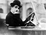 Charlie Chaplin Ridding in Vehicle Foto von  Movie Star News