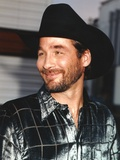 Clint Black smiling in Portrait Photo by  Movie Star News