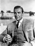 Goldfinger Man Holding Glass of Wine wearing Formal Outfit with Necktie Photo by  Movie Star News
