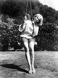 Eva Saint Swinging in Classic Photo by  Movie Star News