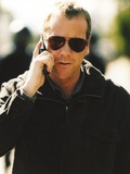 Kiefer Sutherland Calling in Portrait Photo by  Movie Star News