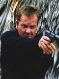 Kiefer Sutherland Pointing a Gun Portrait Photo by  Movie Star News