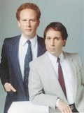 Simon & Garfunkel wearing a Coat and Tie in a Portrait Photo by  Movie Star News