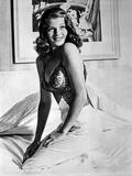 Rita Hayworth Posed Sideways Facing Forward Photo by  Movie Star News
