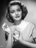 Patricia Neal Holding Perfume in Black and White Photo by  Movie Star News