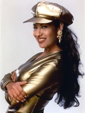 Selena in Gold Suit and Cap Photo by  Movie Star News